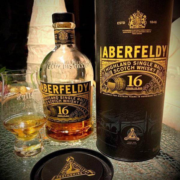 almost empty bottle Aberfeldy 16 years with glass