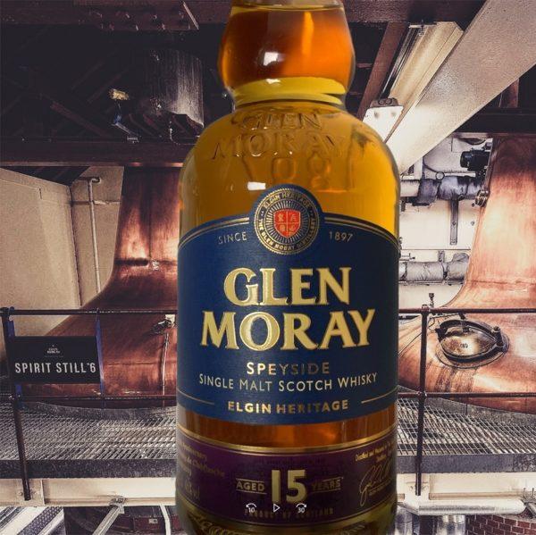Glen Moray 15 years single malt bottle in front of stills in production
