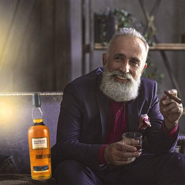 Man with beard in good mood with Talisker Neist Point