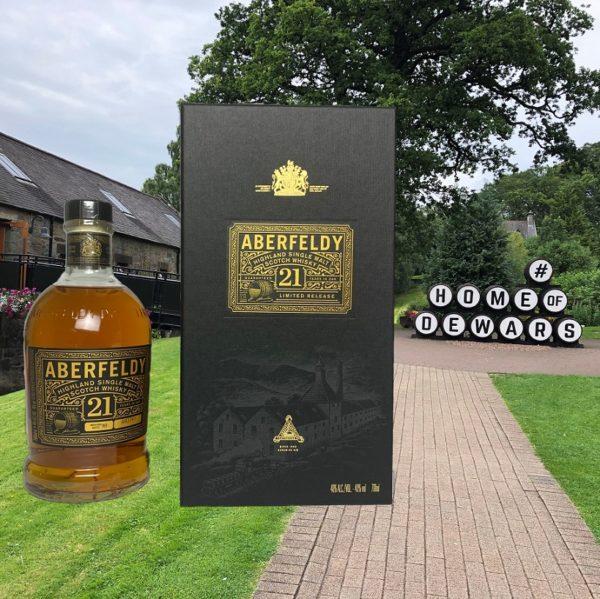 Aberfeldy 21 years single malt in front of distillery