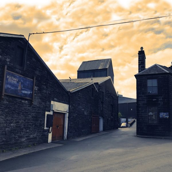 Old Pulteney Distillery at sunset, producing the maritime Malt